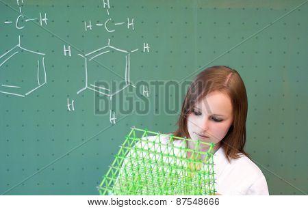 Woman Analyzes A Molecular Model In Lab