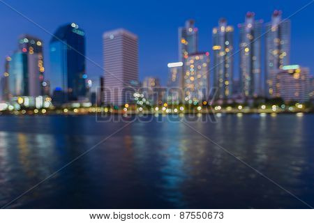Beauty of cityscape blurred bokeh background with water reflection