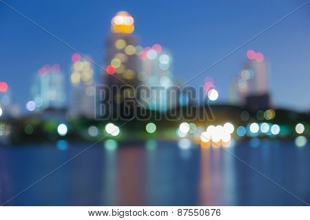 Abstract blurred bokeh water front cityscape view, twilight