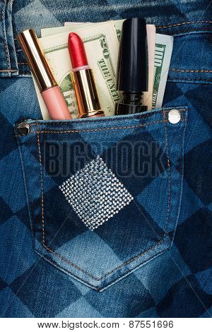 Cosmetics And Money Sticks Out Jeans Pocket