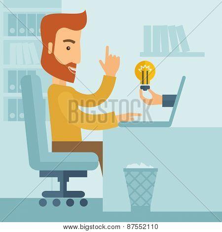 A happy businessman sitting while getting idea