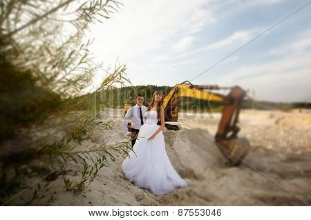 Fun Portrait Of The Bride And Groom On The Beach Near Tractor