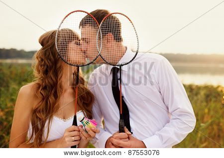 Happy Groom And Bride Playing Tennis In His Wedding Day