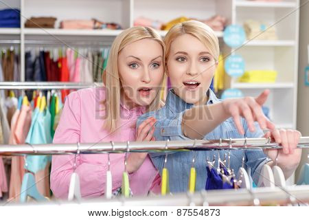 Saleswoman and customer choose clothes