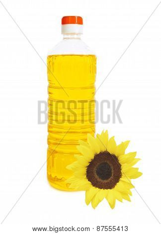 Oil In Bottle And Sunflower Isolated On White