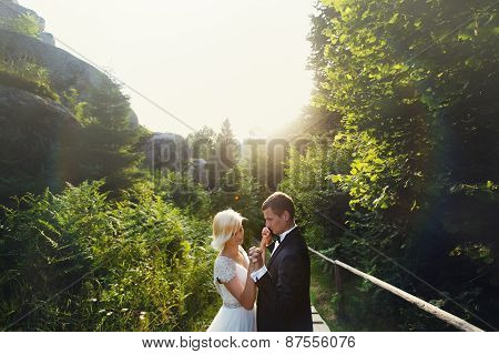 Wedding Couple In A Forest In The Mountains At Sunset