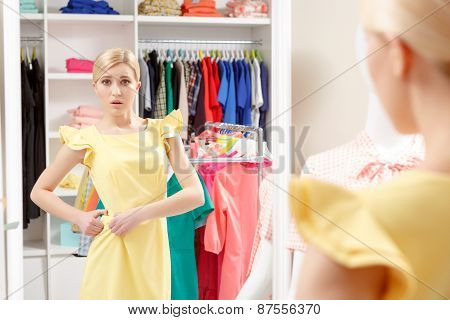 Woman tries a new dress in shop