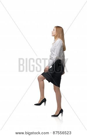 Young Businesswoman Is Going Up. Isolated
