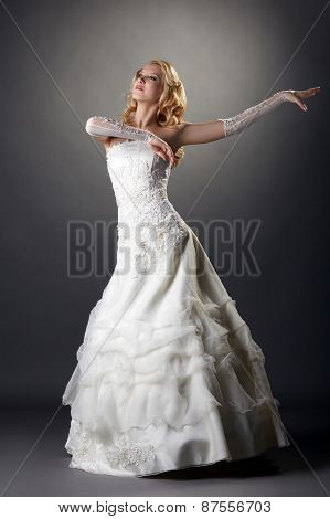 Lovely blonde bride dressed in elegant attire