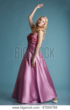 Pretty blonde girl posing in dress for prom