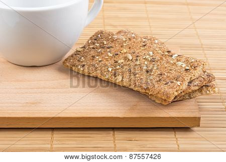 Crispbread And A Fragment Of A White Cup.