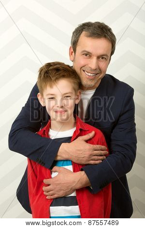 Happy father embracing son