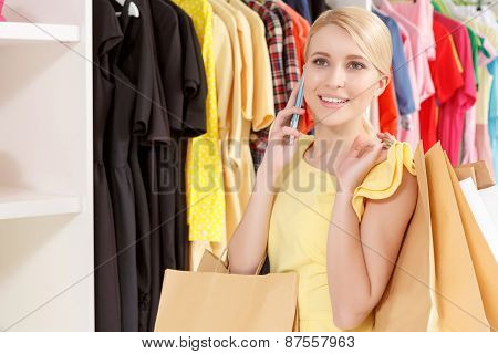 Young shopper speaks over the phone