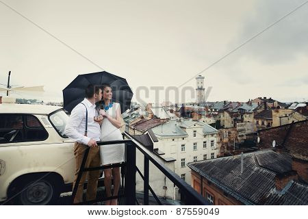 Couple Walk In Old Town Lviv,kissing,loving. On The Roof