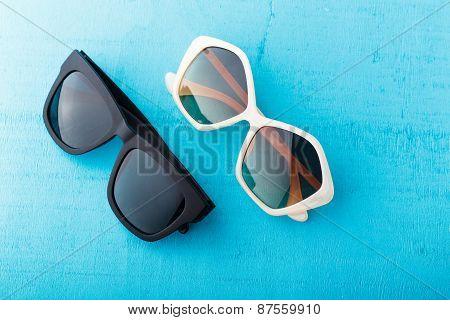 Plastic Sunglasses On Blue