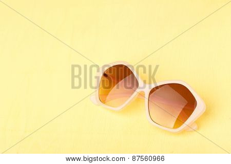 Sunglasses On Yellow Wooden Table