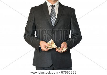 Man In Business Suit Counting Money