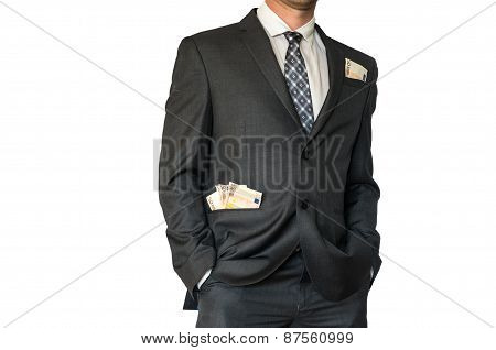 Man In Business Suit With Money In Pockets