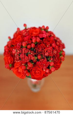 Flower Decoration In Wedding Day. Red Roses And Berries