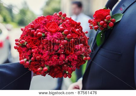 Groom Holding A Beautiful Red Wedding Bouquet