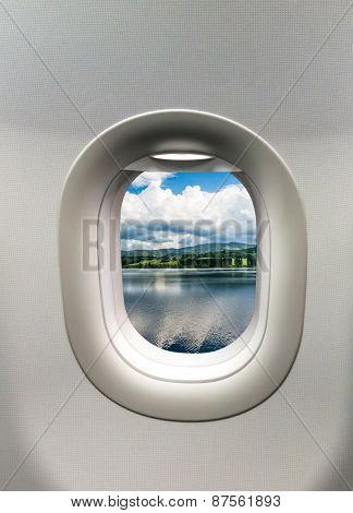 Looking Out The Window Of A Plane At The Lake