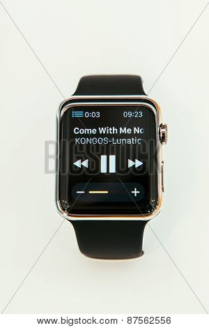 PARIS FRANCE - APR 10 2015: New wearable computer Apple Watch smartwatch displaying the new Remmote App and iTunes Library control. Apple Watch incorporates fitness tracking and health-oriented capabilities and integration with iOS Apple products and serv