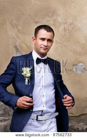 Portrait Of Groom Dresses Jacket