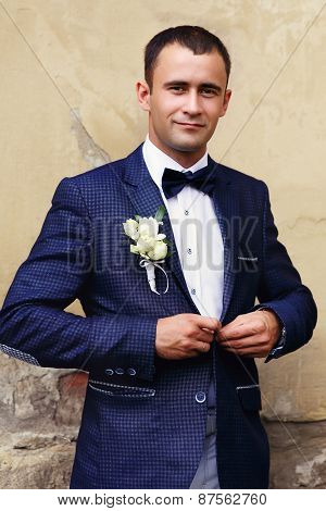 Handsome Groom At Wedding Tuxedo Smiling And Waiting For Bride. Happy Smiling Groom Newlywed. Rich G