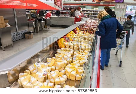 Showcase With Cheese Ready To Sale In Supermarket Magnit, Russia