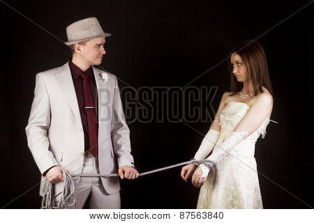 Photo Studio. Groom Snared Rope Bride. Fun