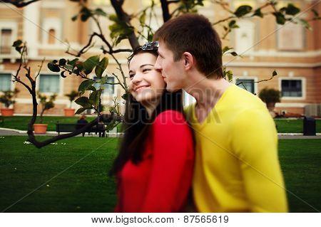 Loving Couple Sitting Near Lemon Tree In The Garden Of The Vatican Museum