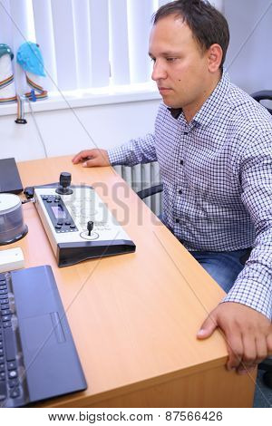 Man at the table with the control panel in the hospital