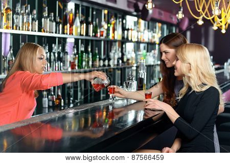 Female bartender makes cocktails