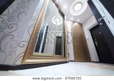 Interior hallway with entrance door and sliding mirror wardrobe, bottom view