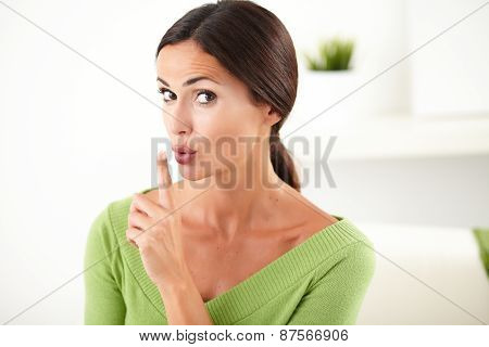 Caucasian Woman Making The Silence Gesture