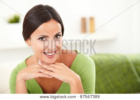 Beautiful Woman In Green Shirt Contemplating