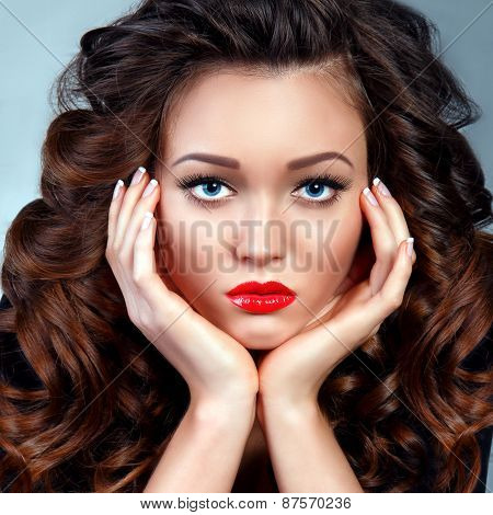 Fashion Portrait Of Young Woman Brunette Model. Volume Curly Long Hair. Red Sexy Lips.