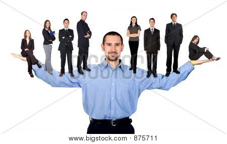 Picture or Photo of Business man with arms open hands facing up with his team