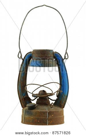 Old and rusty blue vintage oil lamp, isolated on white