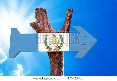 Guatemala Flag wooden sign with sky background
