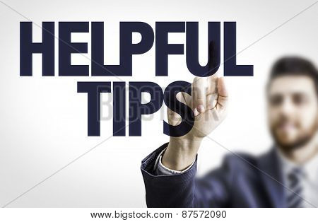 Business man pointing the text: Helpful Tips