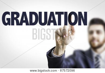 Business man pointing the text: Graduation