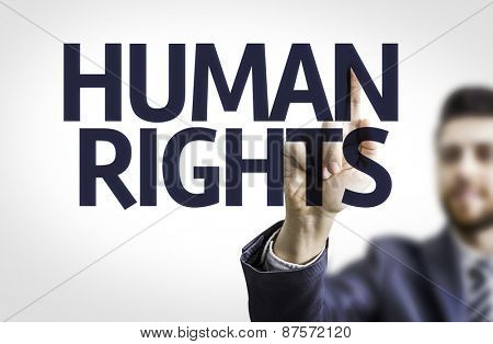 Business man pointing the text: Human Rights