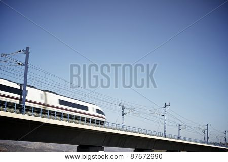 view of a high-speed train crossing a viaduct in Zaragoza Province, Aragon, Spain. AVE Madrid Barcelona.