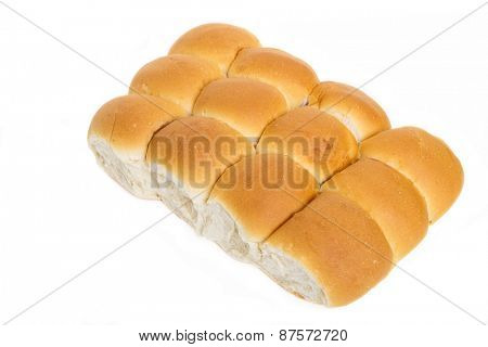 Fresh pan rolls on a white background.