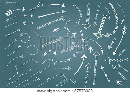 Hand drawn arrow icons set on blue chalk board. Vector Illustration
