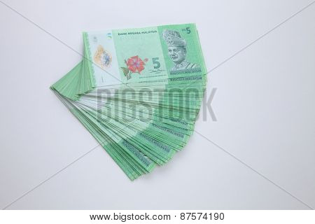 stack of the Malaysia ringgit five dollar form a fan