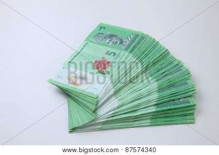 stack of the Malaysia ringgit 5 dollar form a fan