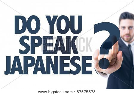 Business man pointing the text: Do You Speak Japanese?
