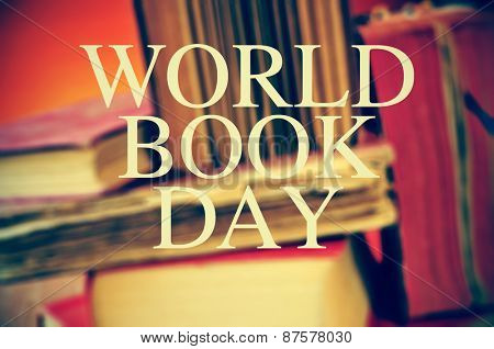the text world book day with a pile of blurred old books in the background